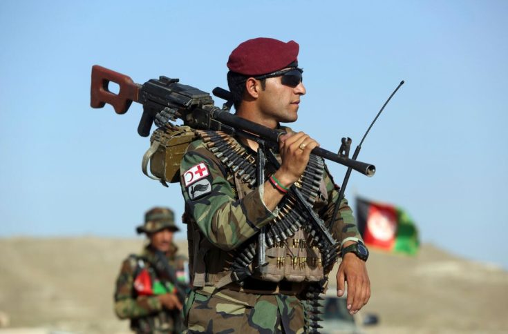 An Afghan soldier stands guard at a roadblock outside Kabul.