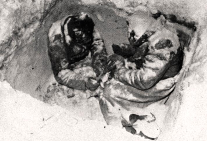 Stiff frozen Soviet corpses in a rifle position