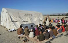 Afghan schoolchildren in an outdoor classroom on the outskirts of Jalalabad, in Nangarhar Province, February 16, 2014.