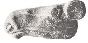 Elk head club of soapstone, approx. 5000 years old. Finland's oldest preserved artifact.