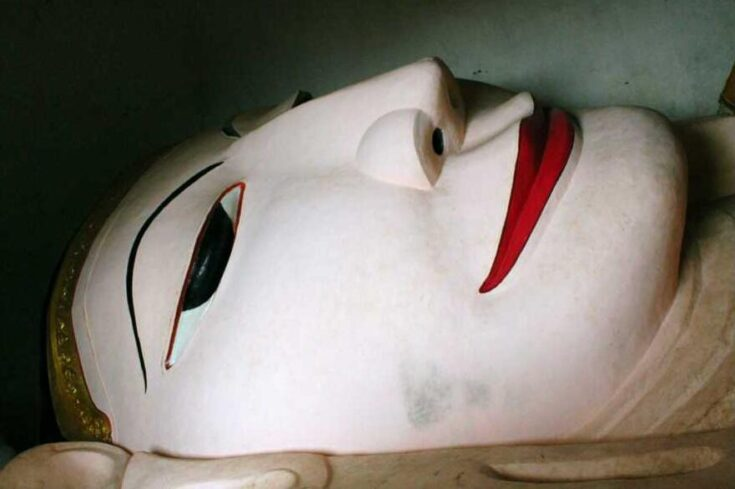 Face of the reclining Buddha in the Manuha Temple Myanmar