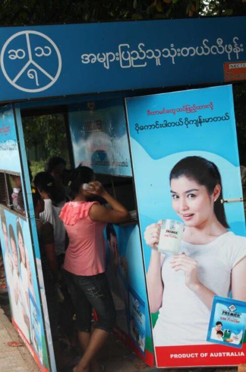 Public telephone at a bus stop in Yangon Myanmar