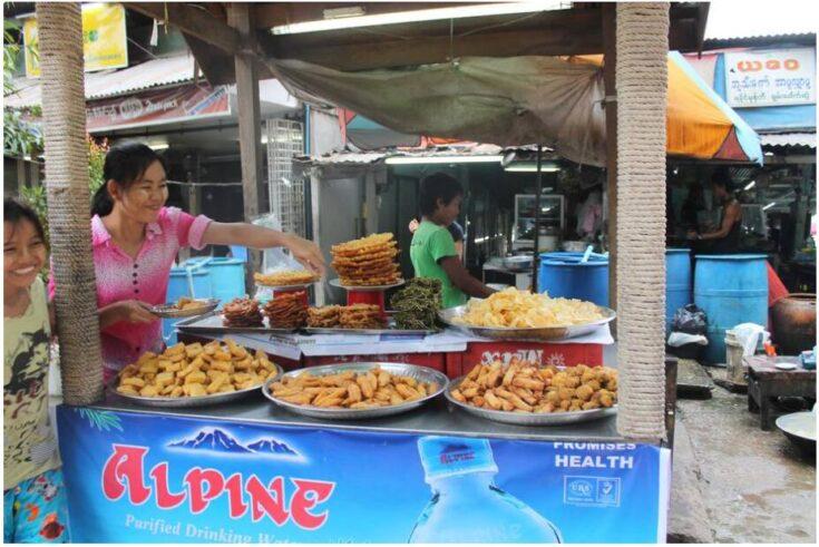 Saleswoman of snacks in Yangon Myanmar